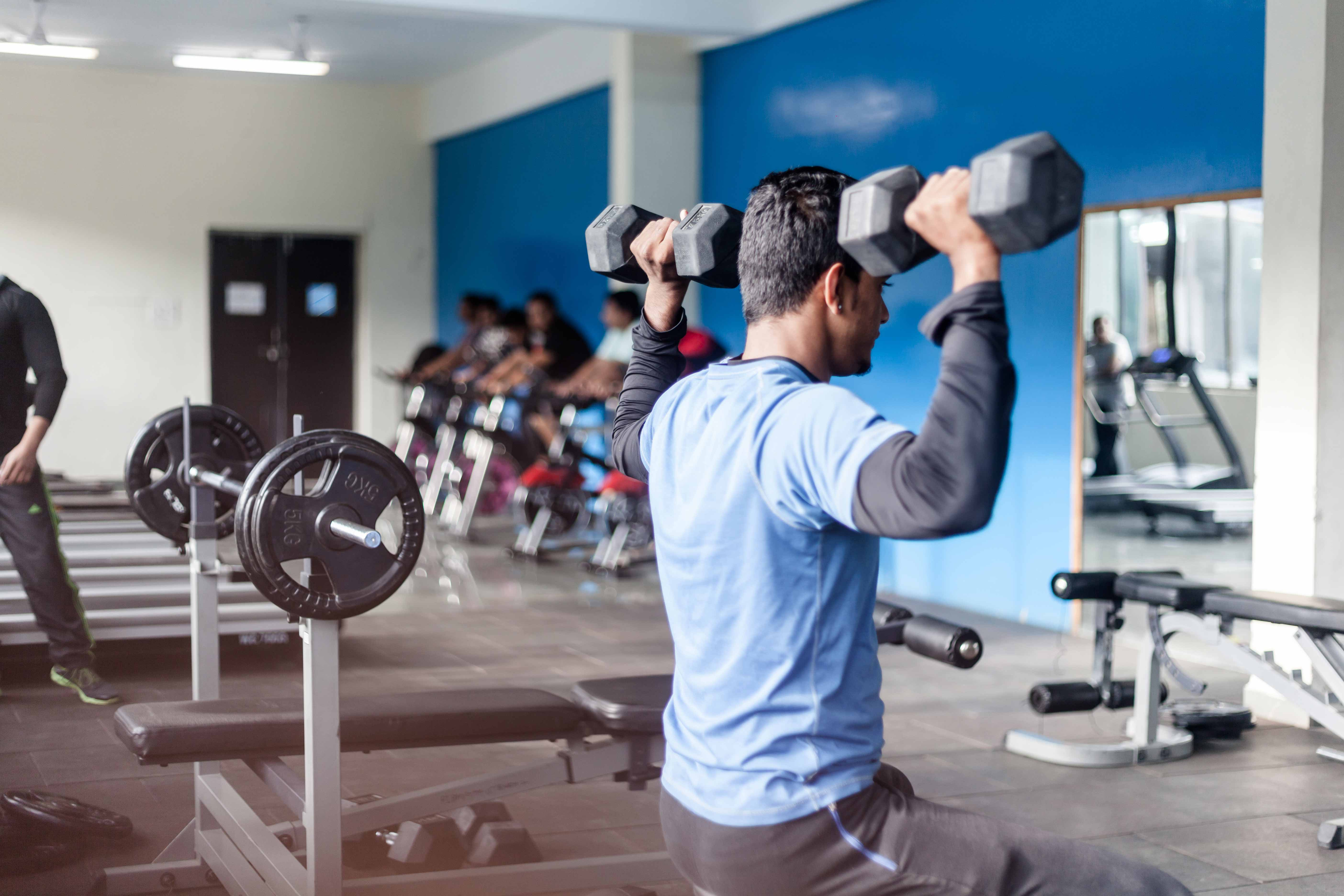Students Of PIBM at Gym using Dumbells_Confidence Building_PIBM Pune