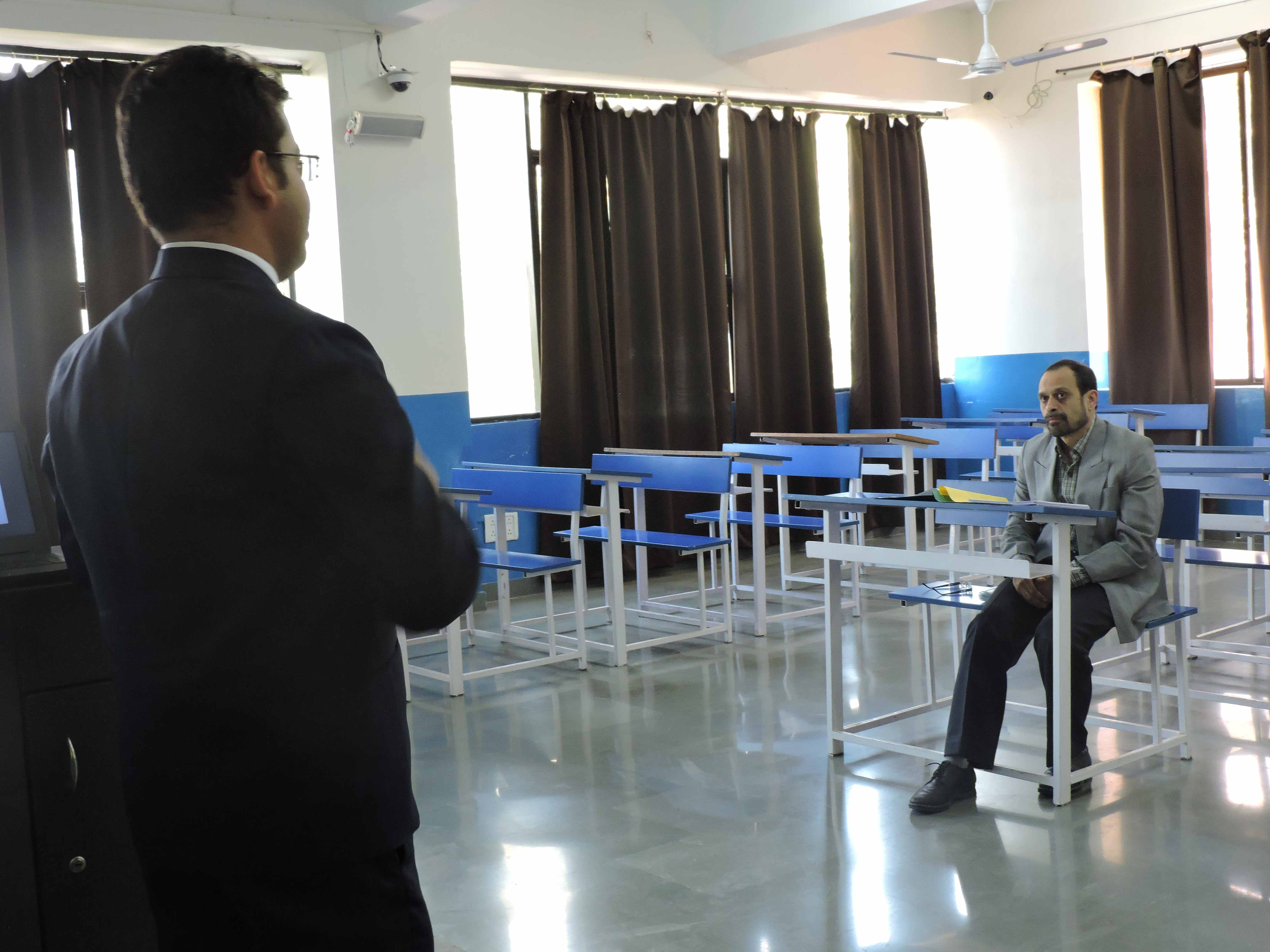 Students giving presentation to Mr. Abhay A. Joshi_Confidence Building_PIBM Pune
