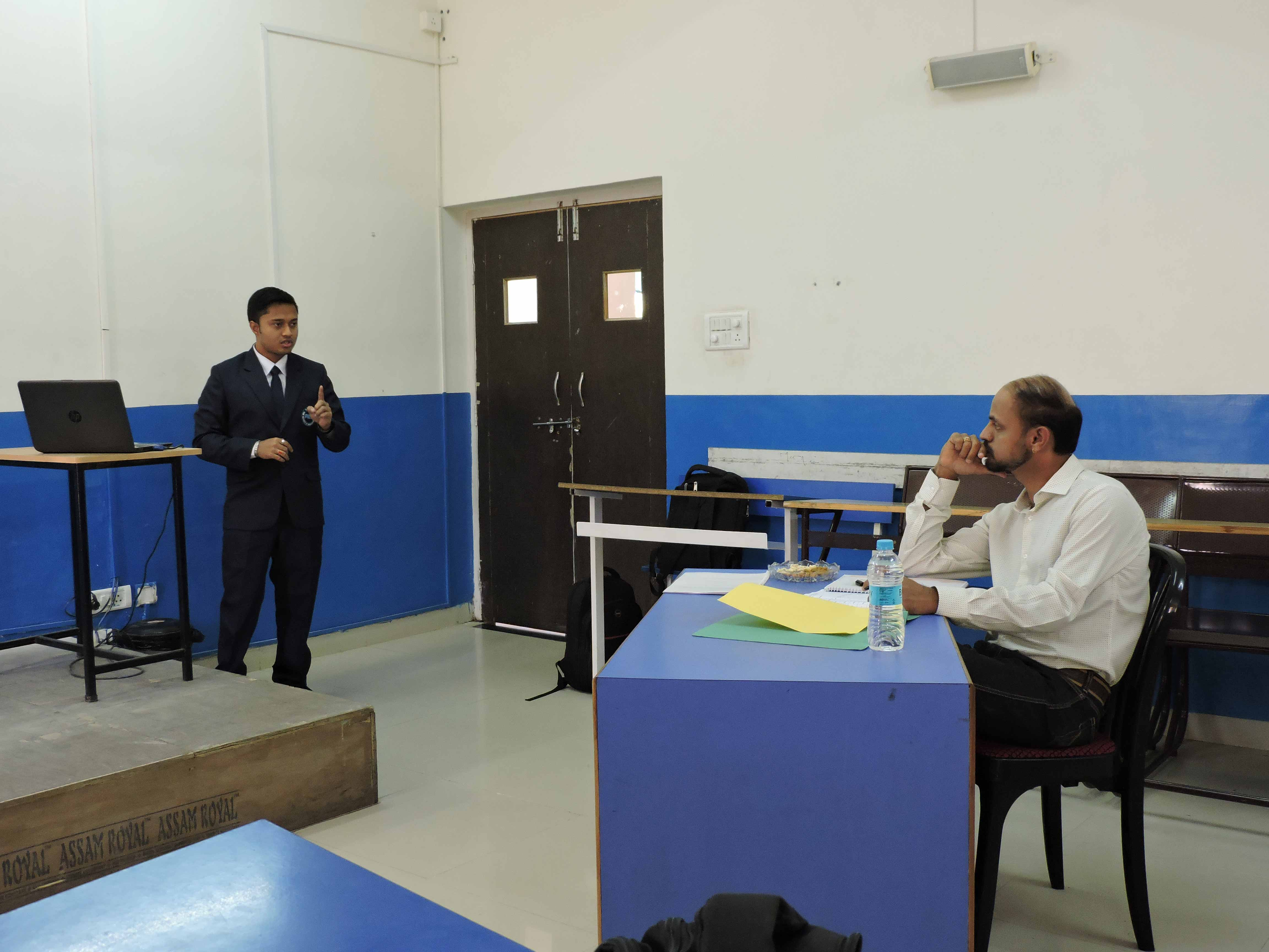 Students giving presentation to Mr. Ashok Iyer_Confidence Building_PIBM Pune